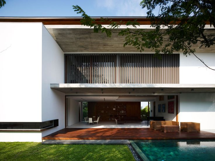"""Singapore-based architectural firm ONG&ONG has completed the M House project in 2011. This contemporary two-story home is located in Bukit Timah, an area in Singapore located near the centre of the Singapore main island.               M House by ONG&ONG: """"Nestled in Bukit Timah, this home provides the ideal balance between the needs for family bonding as well as for personal space. Despite housing numerous bedrooms, communal areas are spacious with a double-volume void in the living area…"""