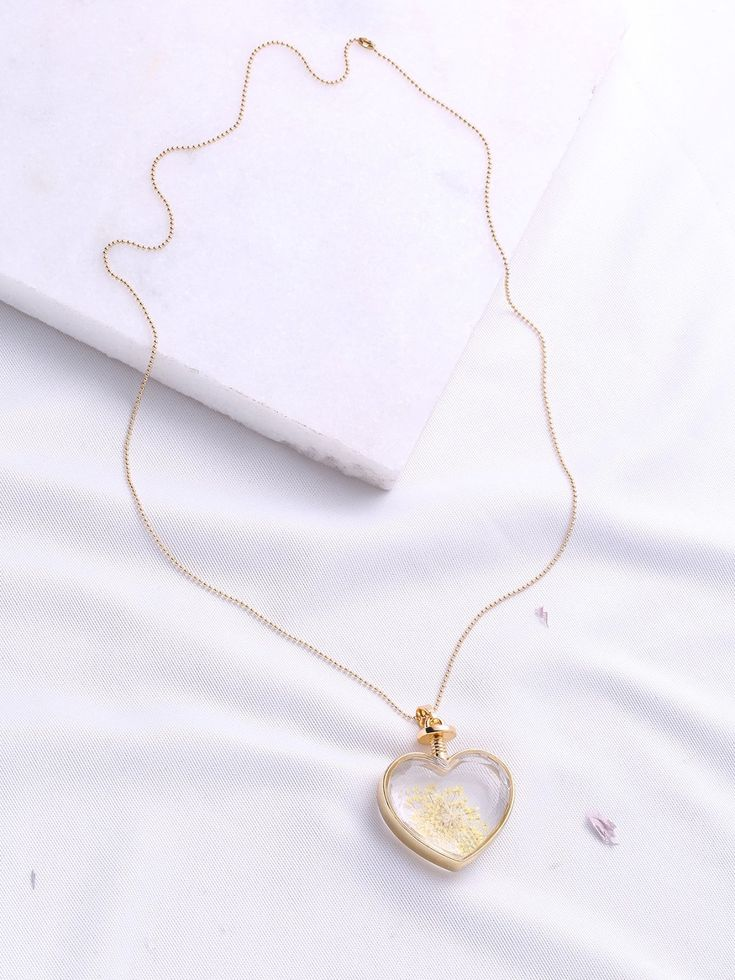 Crystal. Gold colored metal. Pendant Necklaces Heart design. Designed in Gold.
