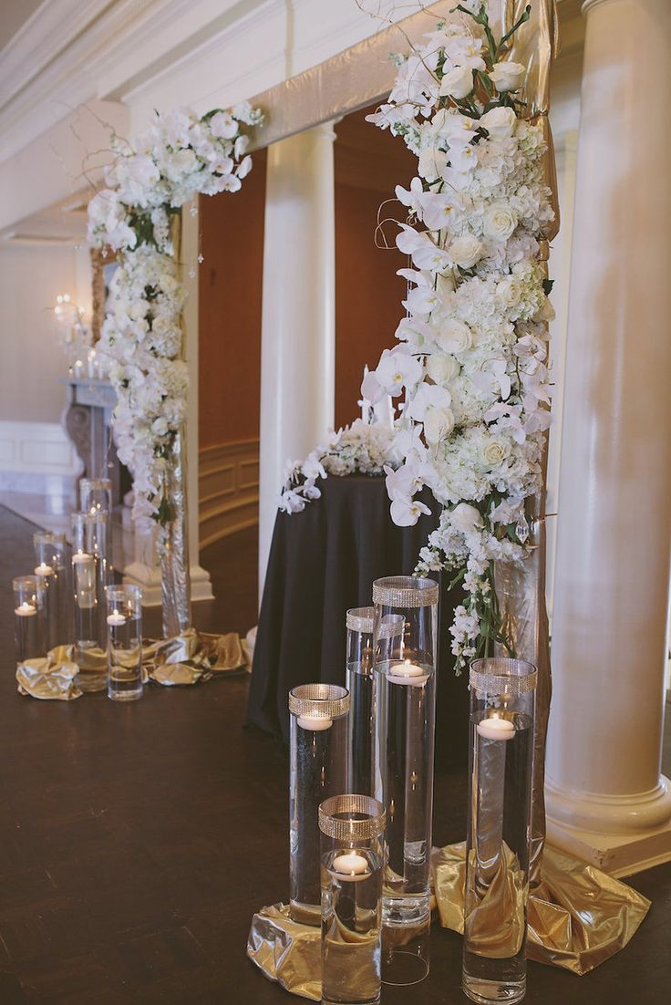 White Orchid, Roses, Floating Candle Vases at Wedding Ceremony Altar   Sarasota Wedding Planner NK Productions