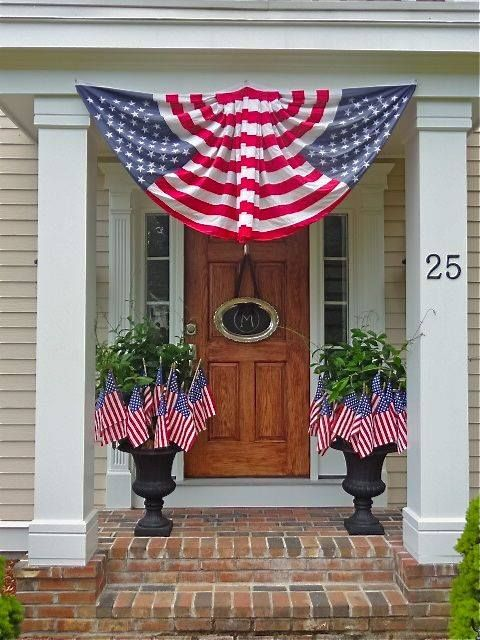Love the ''bunting'', the urns full of flags and the chalkboard platter on the front door! I could easily do that!