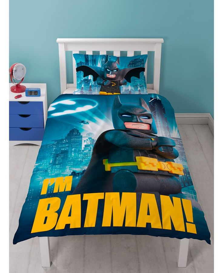 This Lego Batman Movie single duvet cover set makes the perfect addition to any Lego or Batman fan's bedroom. The cool design features Lego Batman on a dark blue city themed backdrop, with the words I'm Batman across the bottom, while the reverse has the Batman logo in a repeat pattern on a blue background