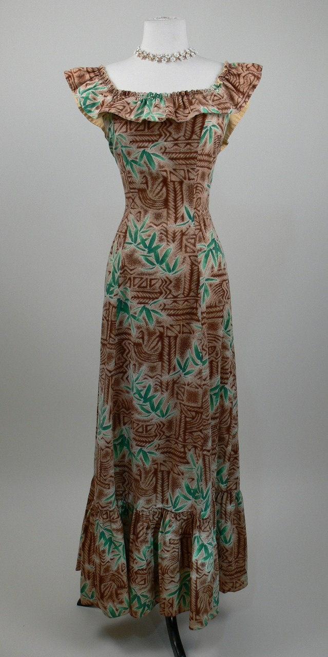 1950's Tiki Print Hawaiian Dress. $98.00, via Etsy.