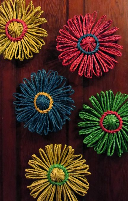 These are pretty awesome and look fairly easy to accomplish. Need laundry or cloth rope and a giant and follow basic flower loom instructions.