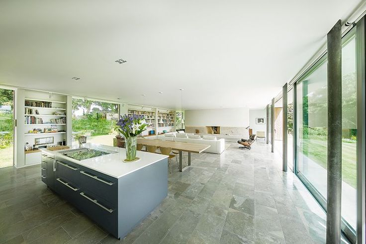 Modern house cantilevers over stone wall in England - Curbed