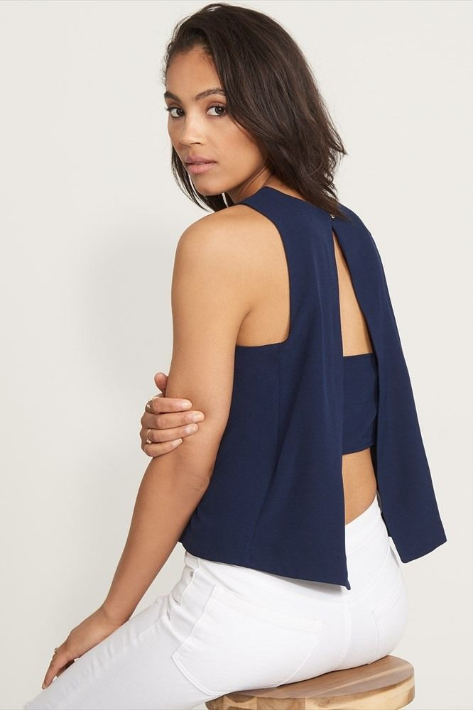 You're not one for the sidelines. Step up your fall wardrobe with this trendy tank top with banded back detail.