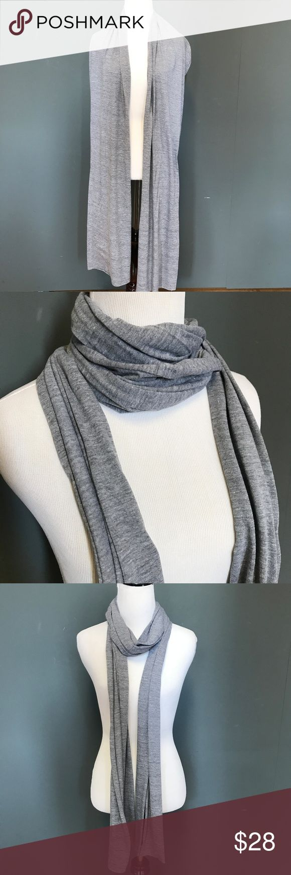 """American Apparel Grey Long Skinny Scarf American Apparel Skinny Scarf Grey Long Cotton Neck Burning Head Man Wrap Hijab  American Apparel's classic light weight skinny scarf.  Approx. Dimensions: 16""""x88""""  Can be used as an scarf, neck wrap, head scarf, or dust mask!  Light weight! Fabric content not listed. I think it's mostly cotton.  Great for Fall, Burning Man, and festivals.  Please check out my Trixy Xchange store for more scarves! :) American Apparel Accessories Scarves & Wraps"""