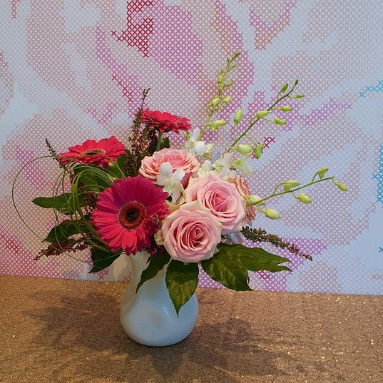 Flower arrangement with Roses, Gerbera Daisies & Orchids