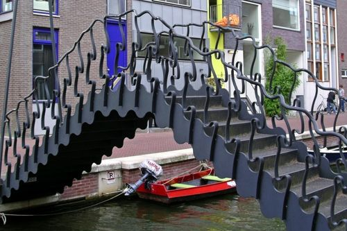 Modern Foot Bridge, Amsterdam's Eastern Harbor by Guy Rombouts and Monica Droste