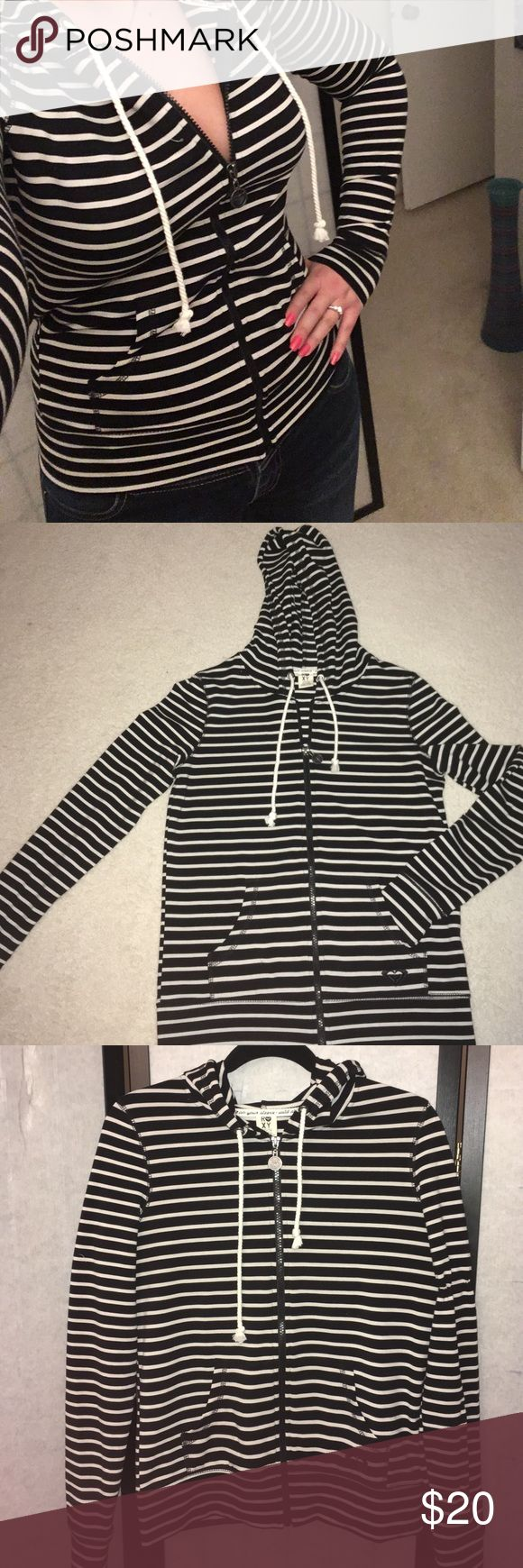 Roxy hooded zip-up Black and white striped, women's size medium, Roxy hooded zip up sweater. Like new only worn once. Roxy Sweaters