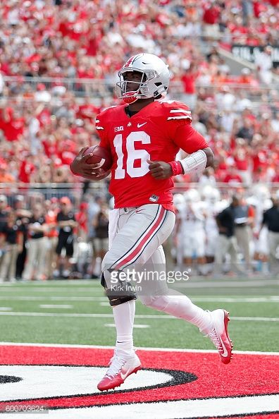 News Photo : J.T. Barrett of the Ohio State Buckeyes scores a...
