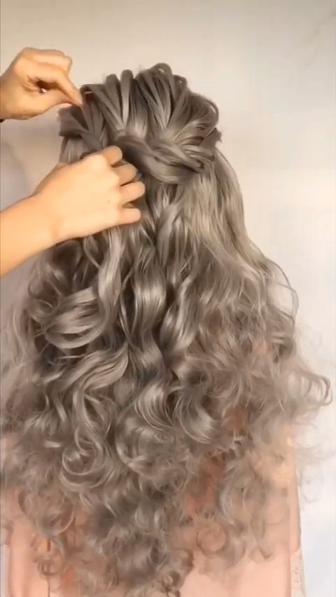 Hair video of how to create this Ethereal Updo with rope braids and topsytails! #weddinghair #hairvideos #weddingupdo #updovideo #weddinghairinspo #hairstylevideo #hairvideo #weddinginspo #weddinghairinspo #bridalbraid #braidedupdo #foxwigs #wigs #synthetic #grey #wavywigs