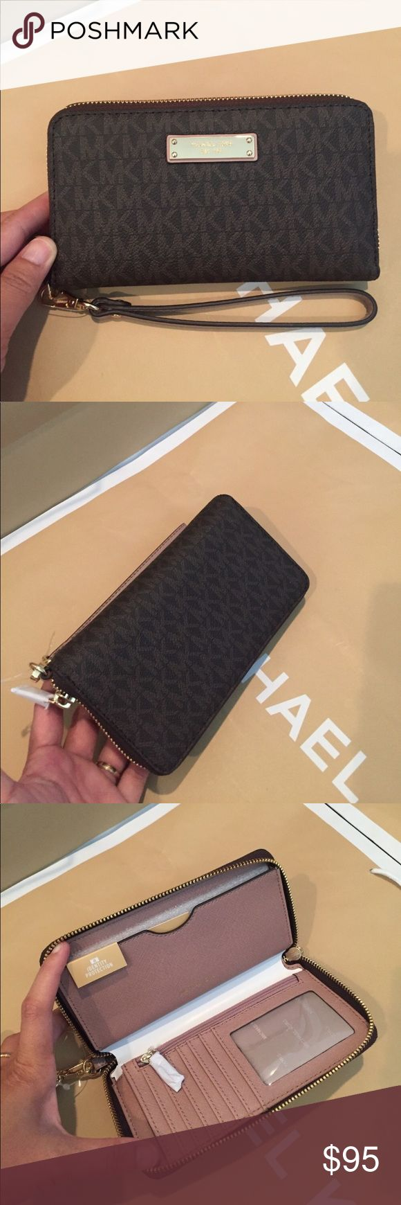 🌴Michael Kors Jet Set Large FM Phone Case🌴🌷 💯 %  Authentic Michael kors Brown/Fawn🌸With a slim removable wrist strap and bold goldtone hardware, this is one piece that's both reliable and refined. Zip around closure. MK logo plaque on front. Lined interior features phone compartment, zip compartment, credit card slots and ID window.   Specifications MaterialMK Signature OriginImported Dimensions6.5 x 4 x 1 in. Care & CleaningSpot clean with damp cloth FeaturesZip around closure. Michael…
