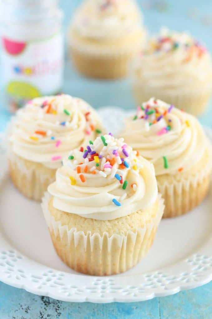Perfect vanilla cupcake recipe topped with an easy vanilla frosting.
