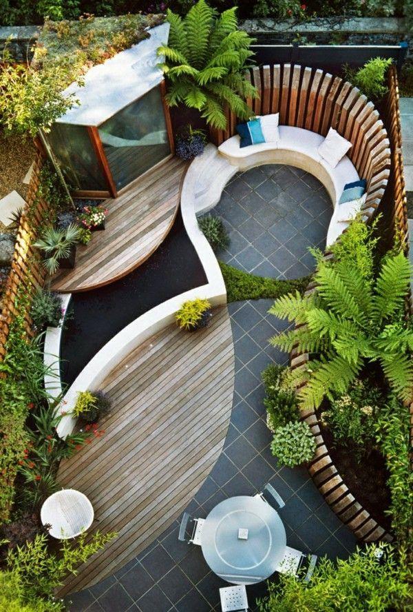 Garden design-curved lines wood garden fence round garden table garden furniture