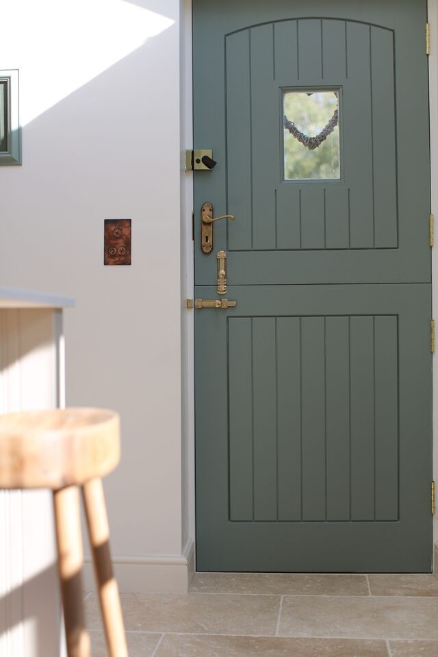 We love the colour of this stable door against our Light Tumbled Travertine.