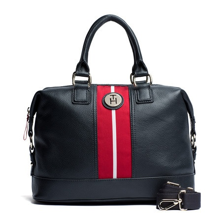 Stand-out in style with this chic duffle. Leather bag with signature contrast webbing at the centre. Shiny, light-gold Tommy Hilfiger badge at the top. Short carry handles and optional short shoulder strap. Open pocket below the zippered top. Midnight twill lining. Reinforced bottom panel. Dimensions: 33 x 15 x 23cm.