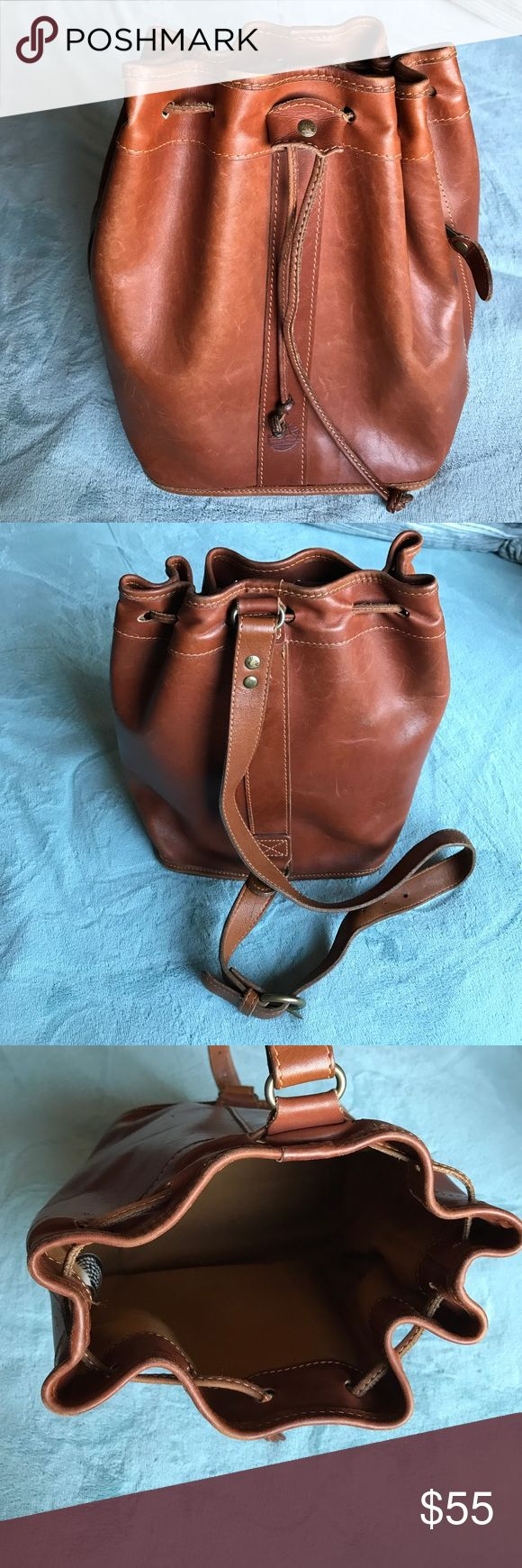 Timberland Bucket Bag Vintage Timberland Bucket Bag. Sling back. It could be a crossbody, but it slings across your back, not on your side. Wonderful brown leather. Made in the USA. Inside zip pocket. Outside size zip pocket (perfect for your cellphone). Timberland Bags Backpacks