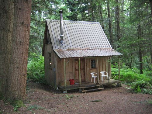 What a beautiful little cabin in the woods! I'll take one for Colorado and one for West Virginia, please!