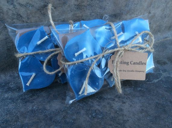 floating candles for pool wedding. floating candles. wedding centerpiece. candle. pool soy candles for
