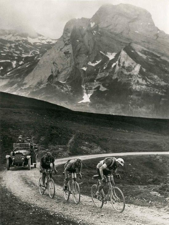 """#retro #pro #cycling"" Those guys were riding fixed gear bicycles. Look at the dirt road! Impressive! You can see the lead guy carrying tubes on his shoulder. Badass! True cycling!"