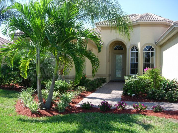 Front yard landscping with border and palms front Florida landscape design ideas