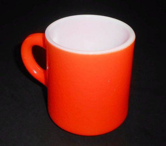 Mug / Cup 1960s Orange  A bright orange coffee cup Has an orange peel texture  No stamp or marking on the bottom Nice condition, no chips or cracks 3