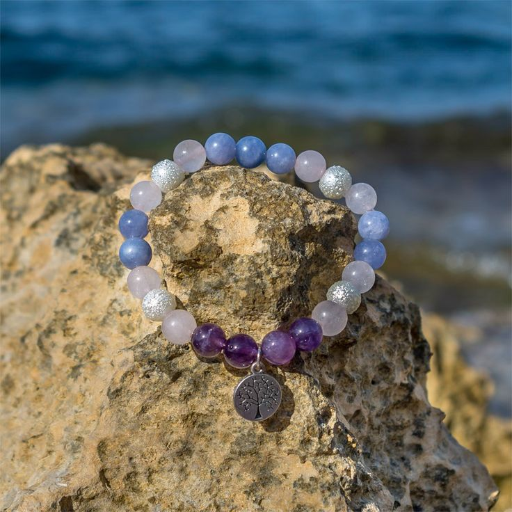 The bracelet is made of  Amethyst, Rose Quartz, Aquamarine and silver synthetic pearls with Tree of Life charm. This one is one of the most favourite healing gemstone bead bracelets for its combination of minerals.