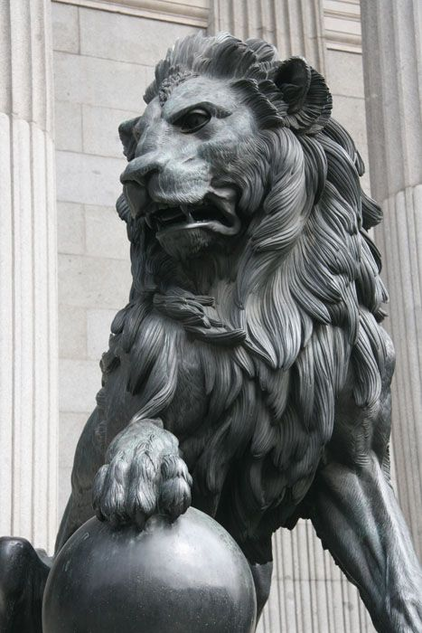 Lion statue outside congress Madrid.
