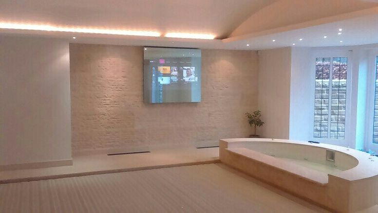 A privacy Mirror TV to keep all of the wires safely tucked away in this beautiful pool room.