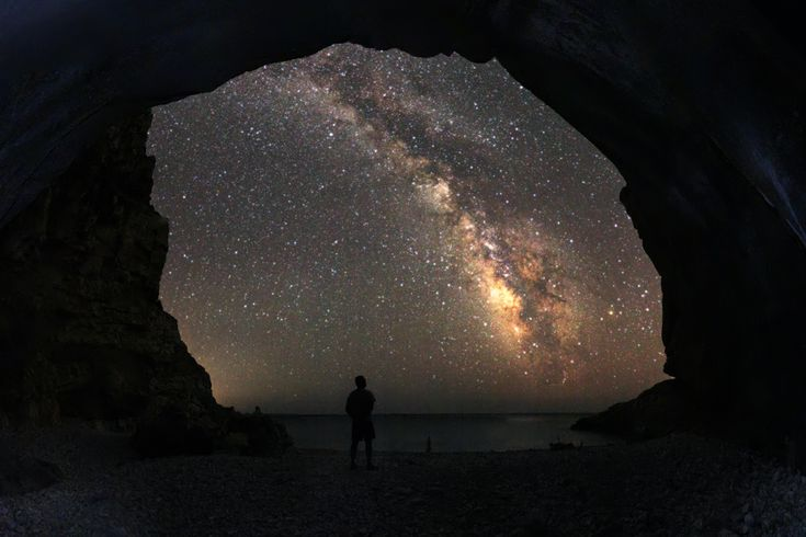 Seychelles beach at Ikaria. A Milky Way view from inside a shallow cave