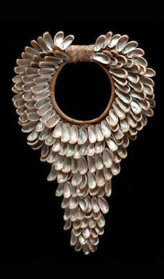 Contemporary necklace from New Guinea    Shells combined with natural fiber