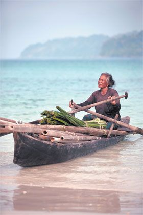 """Moken woman - The """"Sea Gypsies"""" of the Southern Myanmar Coast are quickly declining. They have fought to maintain as many of their traditions as possible, but life has changed and they've found it nearly impossible to survive off the land due to government regulations and heavy competition for fish."""