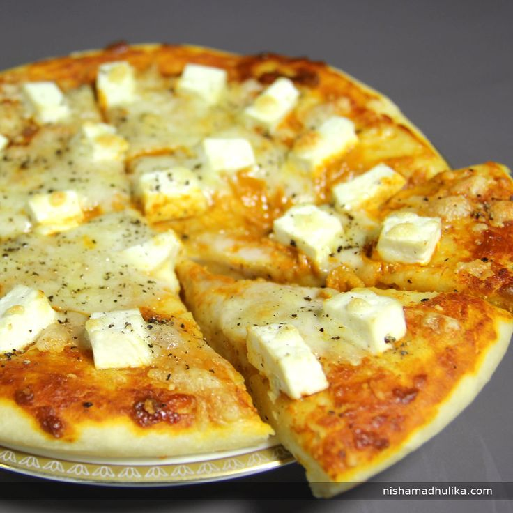 Pickle paneer pizza, delicious pizza with tangy twist. Now a day, pizza is relished the most by everyone and it is available in various types.  Recipe in English - http://indiangoodfood.com/1980-achari-paneer-pizza-recipe.html (copy and paste link into browser)  Recipe in Hindi- http://nishamadhulika.com/910-paneer-pickle-pizza.html (copy and paste link into browser)