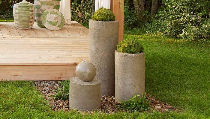 Concrete fountain beside a platform deck