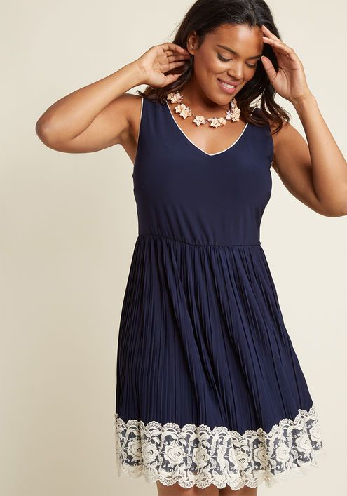 Personal Essayist A-Line Dress in Navy - As you reveal your story to the world, you can't help but radiate confidence, bolstered by this navy blue frock! The V-neck and -back of this pleated A-line catalyze the courage you need to take the stage, as the lace-trimmed hemline ensures all eyes are on you.