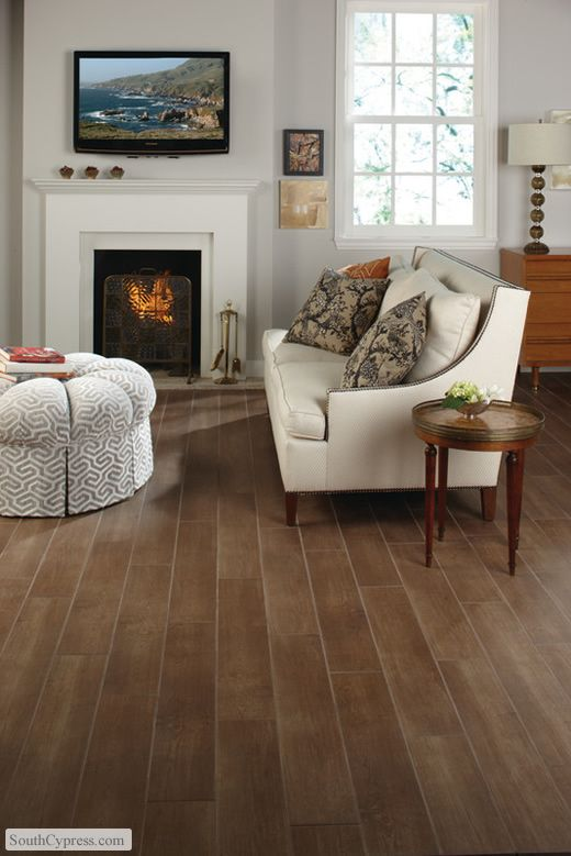 ceramic tile that looks like hardwood floors. We have this and LOVE it, easy to clean/maintain and no scratches!