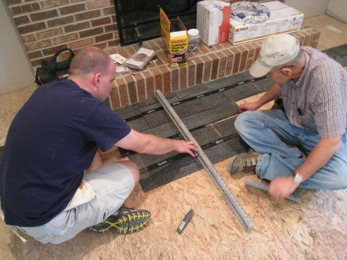 Use roofing shingles to level plywood sub floor in preparation for hardwood flooring installation.