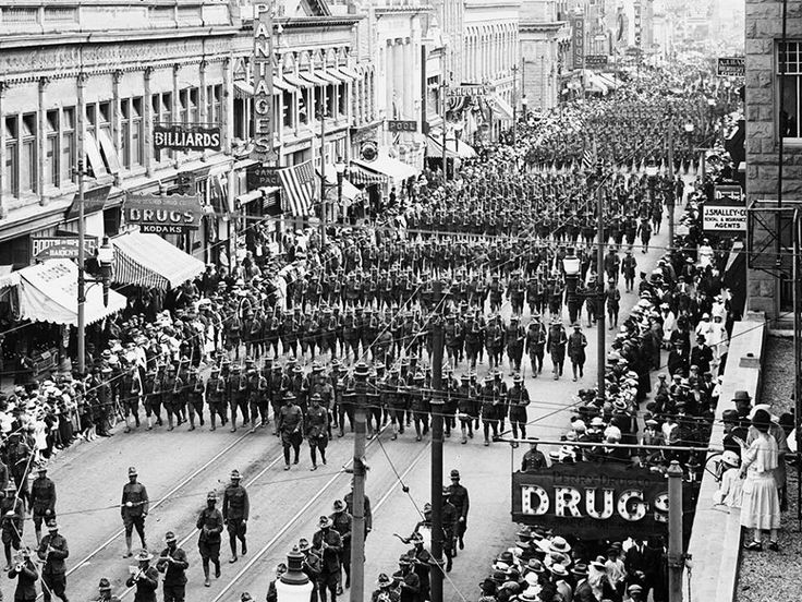 1918: the Armistice parade on Stephen Avenue, between 1st Street S.W. and Centre Street, Calgary. From the Glenbow Archives.