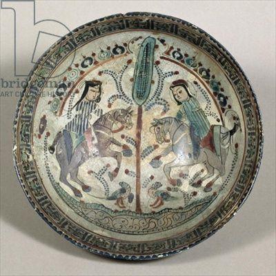 : Raqqa bowl decorated with two men on horseback, Syrian, Seljuk period (pottery), Syrian / © Oriental Museum, Durham University, UK / The Bridgeman Art Library