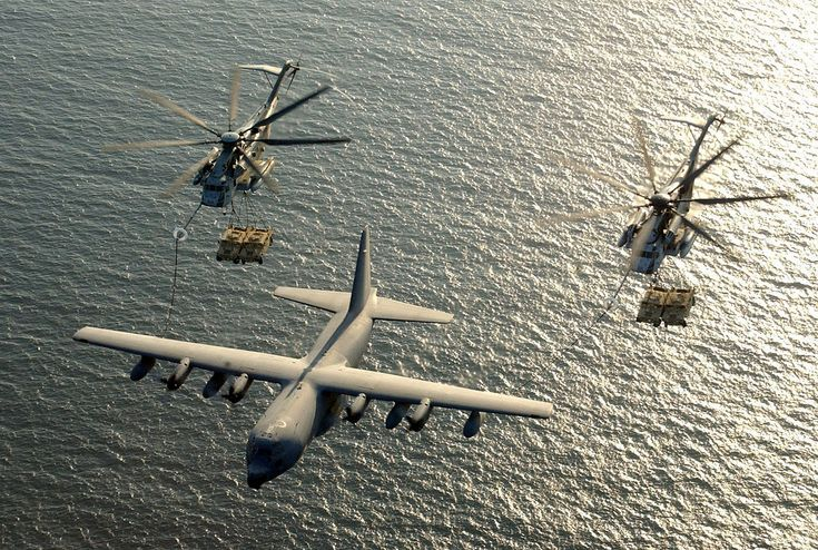 Two U.S. Marine Corps CH-53E Super Stallion helicopters assigned to Marine Heavy Helicopter Squadron-772 (HMM-772) receive fuel from a KC-130 Hercules - Sikorsky CH-53E Super Stallion.