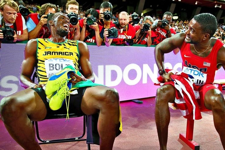 Bolt talks to Gatlin after adding the 200 metres title to the 100 metres gold he won earlier in Beijing