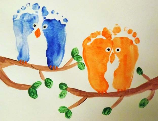 Who doesn't love a good piece of footprint or handprint art? How about some owl art, made with your kids feet?