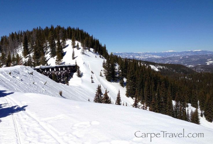 Grand Adventures Snowmobiling Tours: Snowmobiling along the spine of continental divide. Click through for the full review.