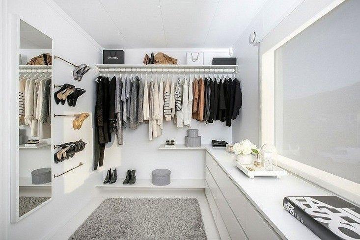 simple AMAZING walkin closet with 5 bathroom towel…