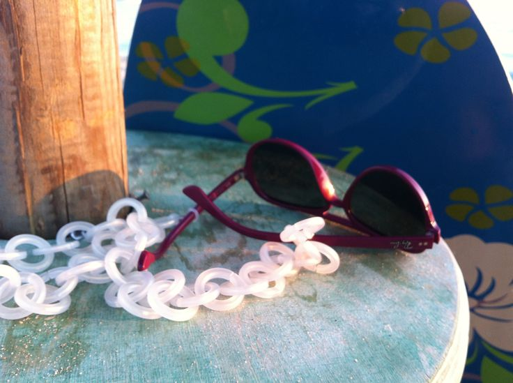 White plastic sunglasses chain. Get ready for the beach.