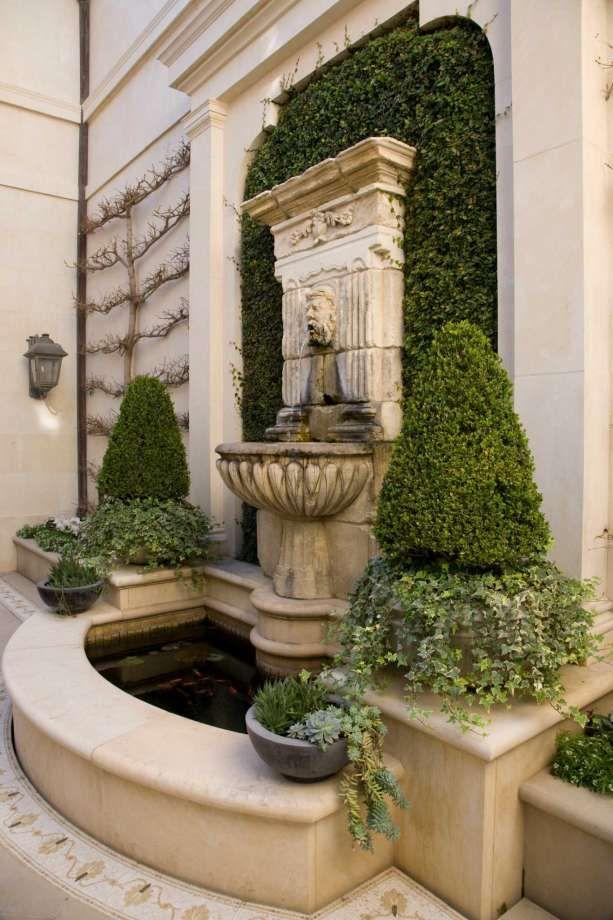 Symmetry Helps Create A Restful Courtyard In A Garden