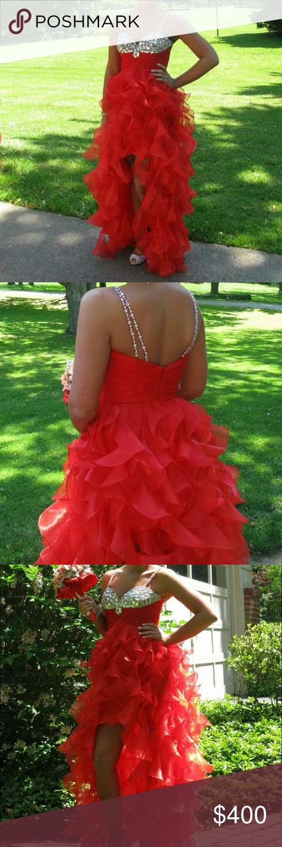 Sherri Hill Red Prom/Formal Dress Sherri Hill dress worn once. Still in great condition. Sparkles on the top and spiral ruffles on the bottom. High low type dress with opening in the front. Small straps to help keep it up! Sherri Hill Dresses Prom