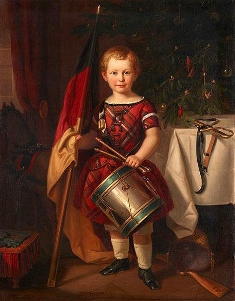 Child In Front Of A Christmas Tree Holding a German Flag