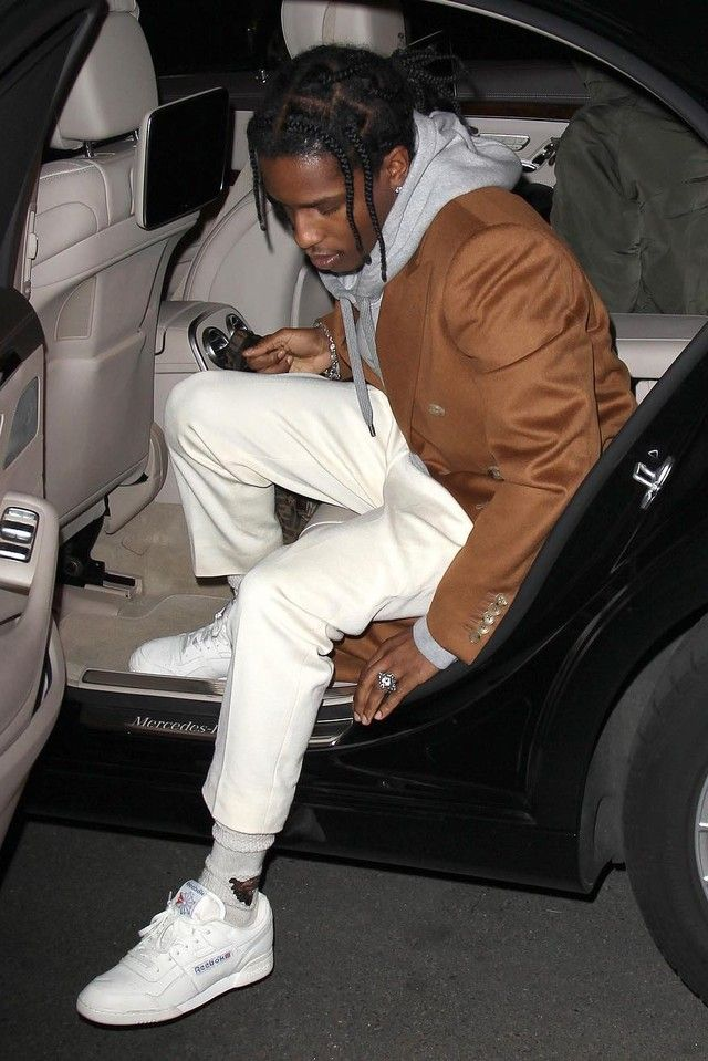 ASAP Rocky wearing  Reebok Workout Plus Vintage Sneakers, Gucci Hooded cotton sweatshirt with Gucci print, Gucci Wool blend socks with bee