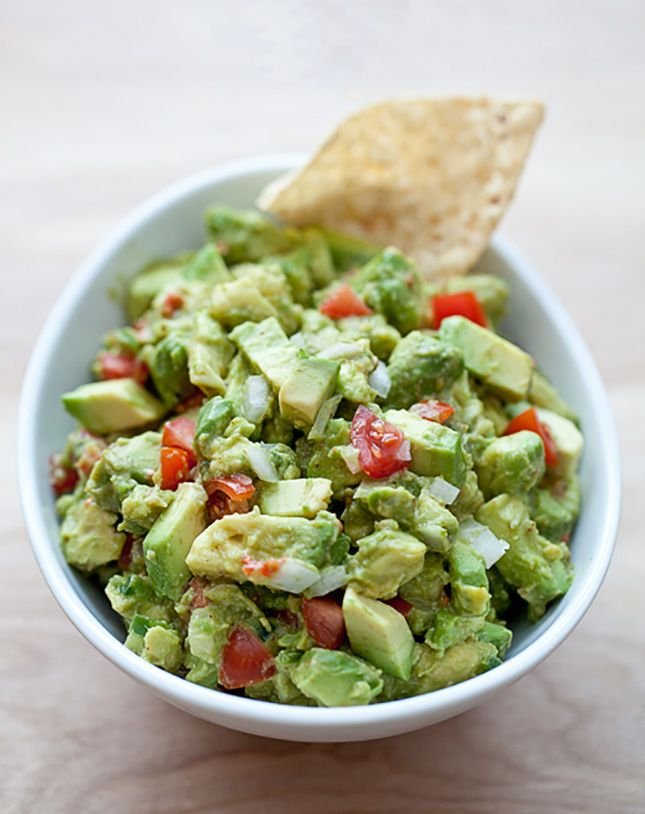 Mix together orange + lime juices with paprika + chili powder to make this Chunky Citrus Guacamole recipe.